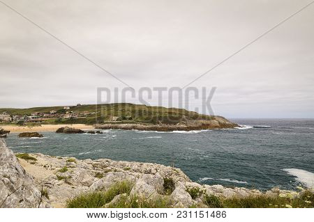Beautiful And Rocky Green Coastline For The Holidays