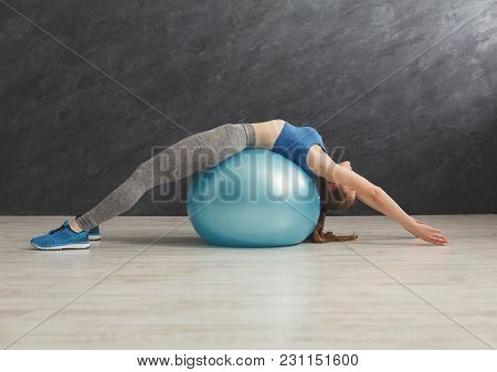 Fitness Woman Training With Fitness Ball At Gym. Young Slim Girl Making Aerobics Exercise, Copy Spac