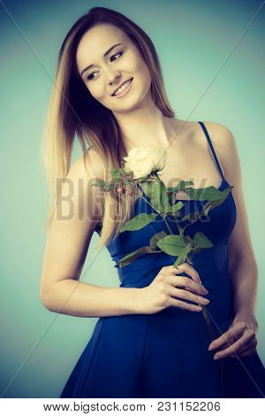 Attractive Blonde Young Woman Holding White Rose Flower. Valentines And Womens Day, Gift Concept.
