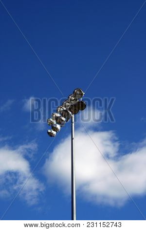 A Set Of Stadium Lights Against Blue Sky