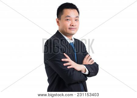 Portrait Of Confident Young Asian Businessman Standing With Arms Folded. Businessman Black Suit Arms