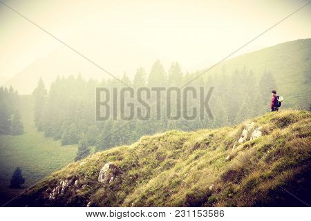 Young Woman Looking Into A Mountain Landscape In Summer, Strong Woman In Nature, Woman Alone In Moun
