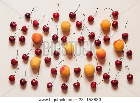 Colourful Bright Pattern With Ripe Cherry And Apricot. Top View.
