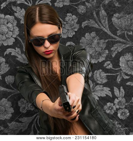 Woman Aiming With Gun against a vintage background