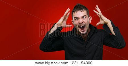 Portrait Of Frustrated Man against a red background