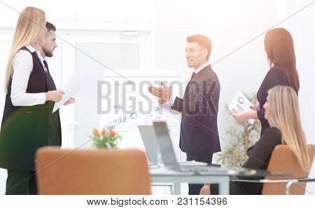 businessman makes a presentation to his business team