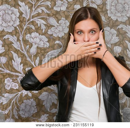 Shocked woman covering her mouth against a vintage background