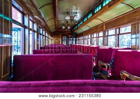 Antique Passenger Car Interior With Red Louver Seats Restored