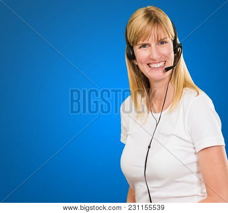 Happy Woman On Headset against a blue background