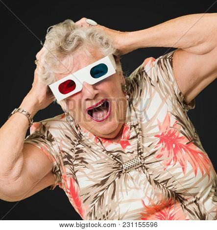 Shocked Senior Woman Watching 3d Movie On Black Background
