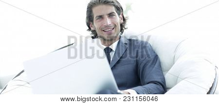 Close-up portrait of a successful business man with a laptop.