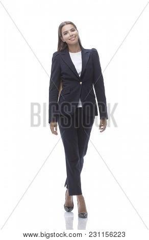 young business woman walking forward.