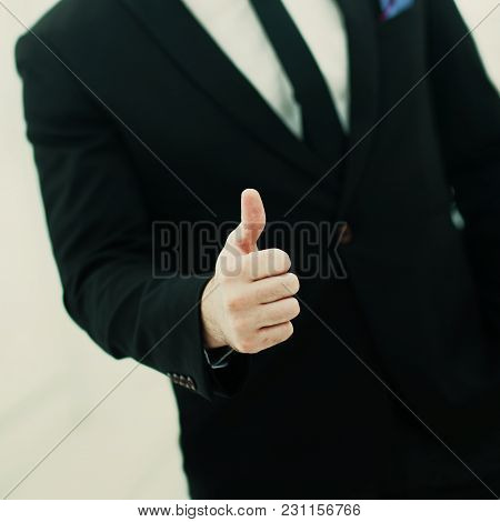 Closeup Of Businessman Making A Gesture - Thumbs Up On White Background.