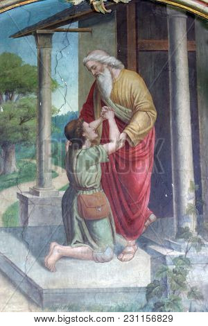 LIPNIK, CROATIA - JULY 02: Return of the prodigal son, fresco in the Saint Eliah church in Lipnik, Croatia on July 02, 2016.