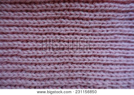 Ribbing Technique On Pale Pink Knitted Fabric