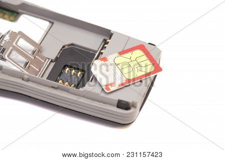 Sim Card On Mobile Phone Isolated On White