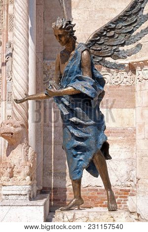 VERONA, ITALY - MAY 27: Angel statue outside of the Cathedral dedicated to the Blessed Virgin Mary under the designation Santa Maria Matricolare in Verona, Italy, on May 27, 2017.