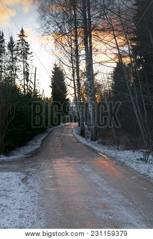 Beautiful Winter Landscape Wit Road To Sunset. Crossroads. Dirty Bad Road.