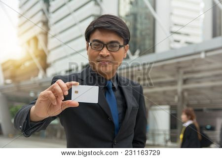 Businessman Holding A Blank Smart Card In Hand
