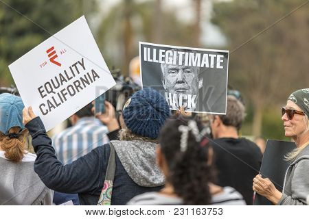 Beverly Hills, California - March 12, 2018: Protester Holds A Sign With A Photo Of President Trump W