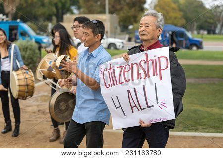 Beverly Hills, California - March 12, 2018: A Protester With The Korean Resource Center Holds A Sign