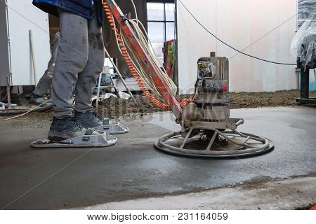 Builders Pour Concrete In The Shop At The Factory
