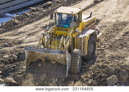 Loader Sand Construction Of High-rise Building Spring Day