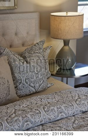 Cozy, Neutral Bed Linens, Pillows And Cushions On A Bed.