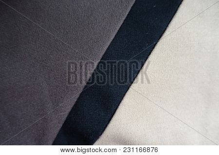 Stripe Of Black Fabric Sewn Across Grey And Beige Ones