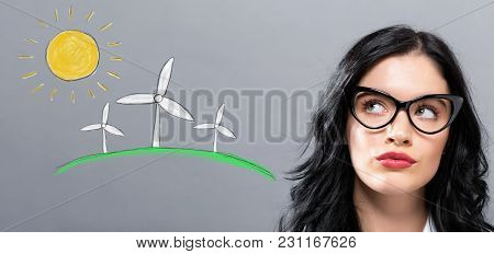 Windmills With Young Businesswoman In A Thoughtful Face