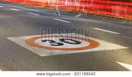 Speed Limit Sign On A Tarmac Road By Night In Italy