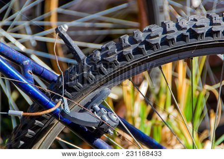 A Wheel Of An Old Bicycle, Brake And The Spokes Of The Wheel