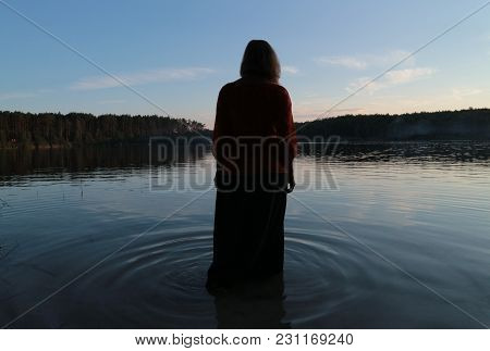 A Girl In The Waters Of The Forest Lake