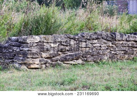 An Old Ruined Wall Made Of Rubble