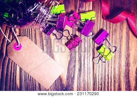 Colorful Paper Clips Spill From Jar With Sale Tag And Red Bow On Wooden Background. Back To School A