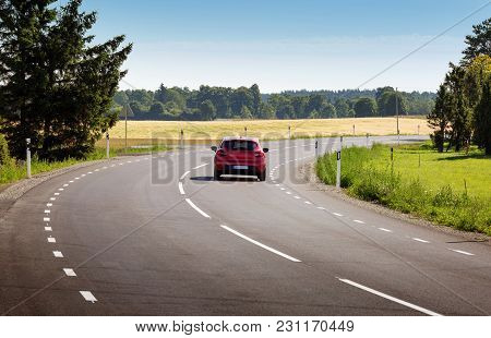 Car On Black Asphalt Road In Beautiful Spring Day At Countryside