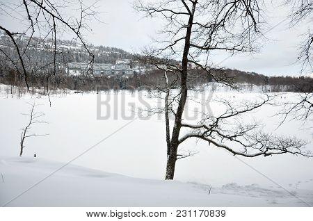 Snowy Lake Bogstadvannet With Houses Voksenlia On The Hillside.