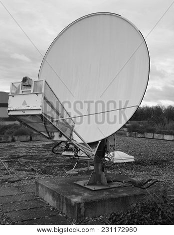 Outdated Satellite Dish From The Front View On The Roof