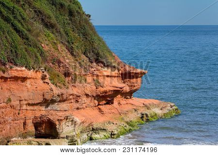 Landscape View With Red Rocks On The Beach. This Place Is Near The Town Of Exmouth. Devon. Uk