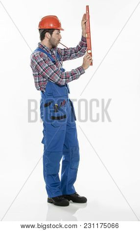 Portrait Of A Craftsman With An Hardhat And A Level On Isolated Background