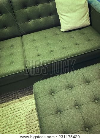 Comfortable Green Sofa With Foot Stool. Modern Design With Retro Feel.