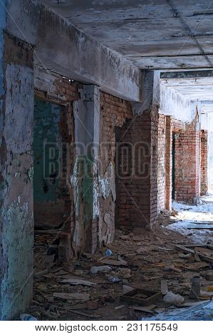 Inside An Old Abandoned Building. The Interior Of The Collapsing Building