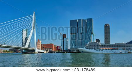 Panorama of Rotterdam cityscape with cruise liner and Erasmus bridge. Netherlands
