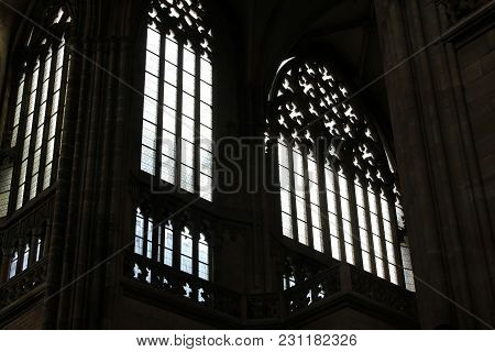 Seeing The Light, Shafts Of Light Stream Through Stained Glass Window And Onto Cross Below.