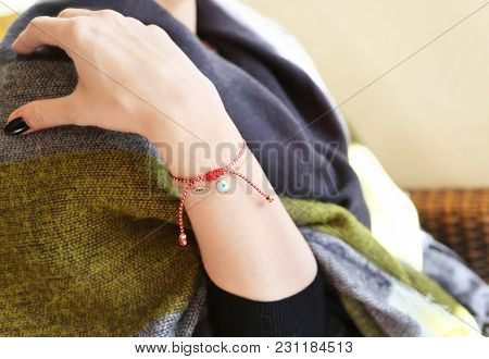 Woman Wearing The Traditional Greek Martaki Bracelet With Evil Eye - Symbol Of Protection