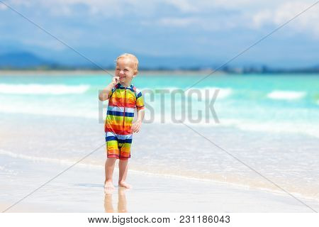 Kids Play On Tropical Beach. Sand And Water Toy.