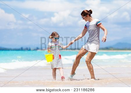 Mother And Child On Tropical Beach. Sea Vacation