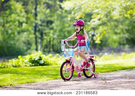 Child Riding Bike. Kid On Bicycle.