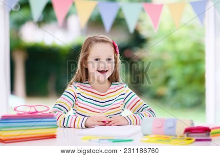 Child Doing Homework For School At White Desk. Little Girl With School Supplies, Abc Books, Drawing