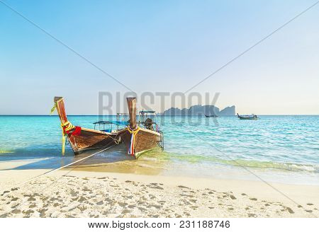 Two Traditional Thai Longtail Wooden Boats At Famous Sunset Long Beach, Thailand, Koh Phi Phi Don Is